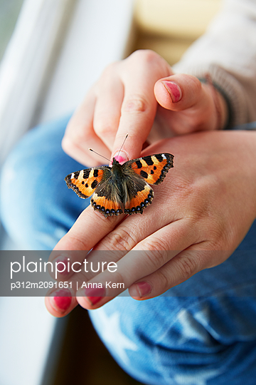 Butterfly on hand - p312m2091651 by Anna Kern