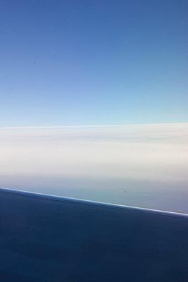 Airplane wings in the blue skies - p1096m1028513 by Rajkumar Singh