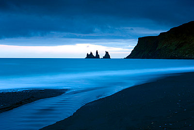 Twilight view towards rock stacks at Reynisdrangar off the coast at Vik, South Iceland, Iceland, Polar Regions - p8713744 by Lee Frost