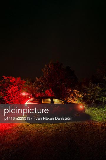 Illuminated car at night - p1418m2293197 by Jan Håkan Dahlström