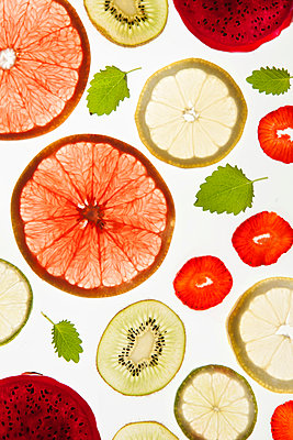 Fruit slices on white background - p312m970978f by Per Eriksson