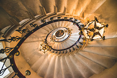 View directly up of a spiral staircase and chandeliers, Duino Castle; Trieste, Friuli Venezia Giulia, Italy - p442m2101118 by Diana Duzbayeva