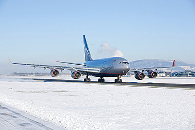 Passenger plane on the runway in winter - p4736571f by STOCK4B-RF