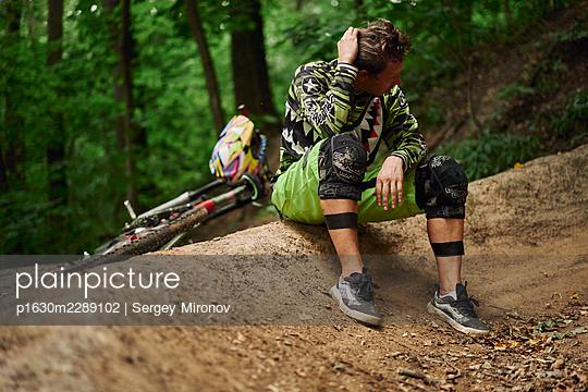 Musing mountainbiker takes a break - p1630m2289102 by Sergey Mironov