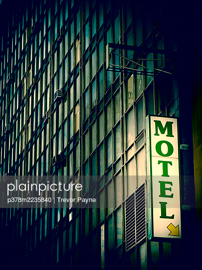 Motel sign and exterior of building - p378m2235840 by Trevor Payne