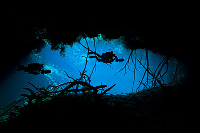 Mexico, Tulum, Two cave divers at the entrance to cenote car wash - p300m980518f by Herbert Meyrl
