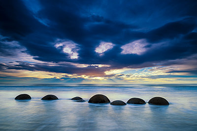 Moeraki Boulders at Sunrise, Otago Coast, New Zealand - p651m2006629 by Tom Mackie