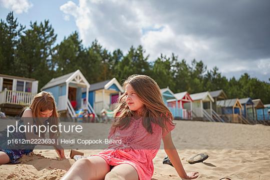 two girls on the beach  - p1612m2223693 by Heidi Coppock-Beard