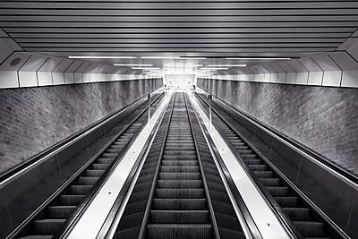 Black and white of ascending escalator - p301m2018321 by Norman Posselt