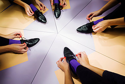 Putting on shoes - p801m1585682 by Robert Pola