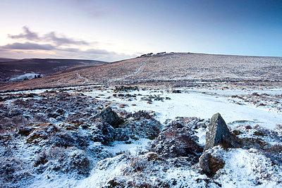 Snow covered stone hut circles in Bronze Age settlement of Grimspound in Dartmoor National Park, Devon, England, United Kingdom, Europe - p8713026 by Adam Burton