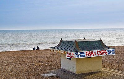 Fish and chip shop on Brighton beach out of season, South Coast of England, United Kingdom - p871m837903 by Tim Graham