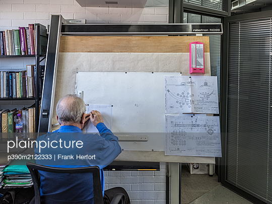 Technical drawer working on drafting board - p390m2122333 by Frank Herfort