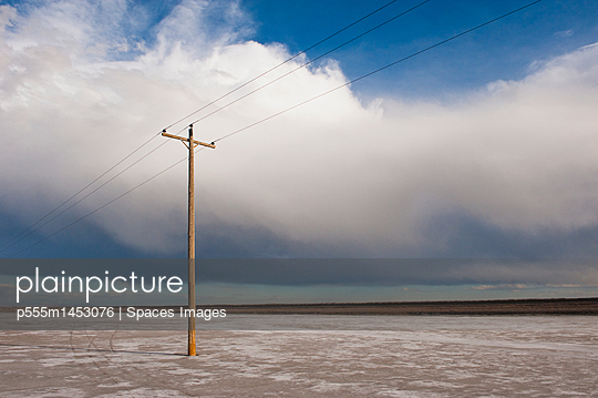 Telephone pole in remote landscape, West Desert, Utah, United States