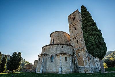 Italy, Tuscany, Montalcino, Facade of Abbey of Sant'Antimo near Montalcino city - p1427m1517365 by Sergey Orlov