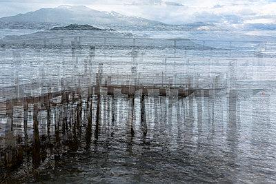 Multiple exposure of a pier in Norway - p1682m2281135 by Régine Heintz