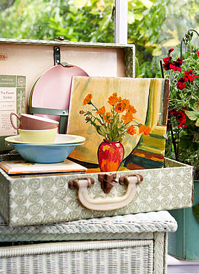 Artwork canvas with plates and bowls in vintage suitcase;  Isle of Wight;  UK - p349m920070 by Rachel Whiting