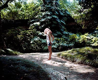Woman in a park - p1083m1011391 by Alain Greloud