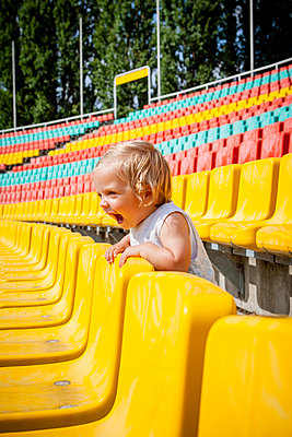 Toddler girl in a stand, Friedrich-Ludwig-Jahn-Sportpark - p1093m2193603 by Sven Hagolani