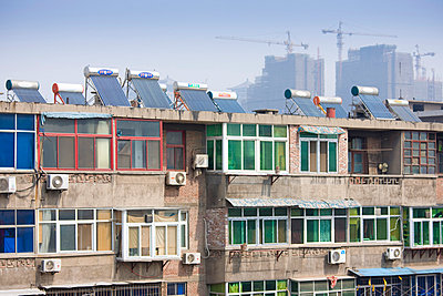 Solar panels and air conditioning on apartments next to the City Wall - p871m873348 by Tim Graham