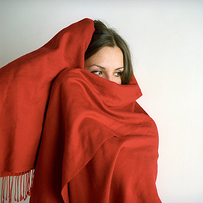 Girl wearing red blanket - p990m694921 by Michael Dooney