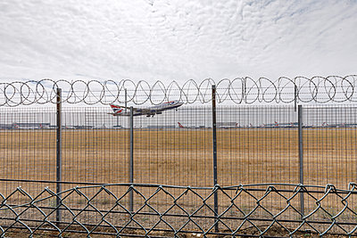 Passenger plane takes off at Heathrow airport - p110m2055447 by B.O.A.