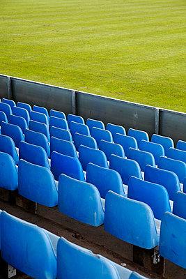Blue seats in a football stadium - p2280511 by photocake.de