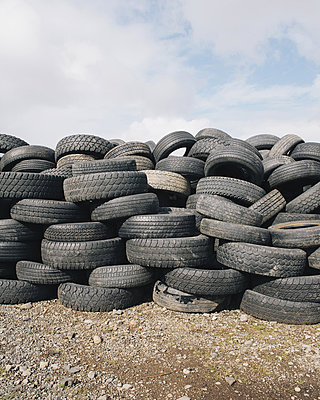 A stack of discarded rubber car tires, collected for recycling, or disposal.  - p1100m876457f by Paul Edmondson