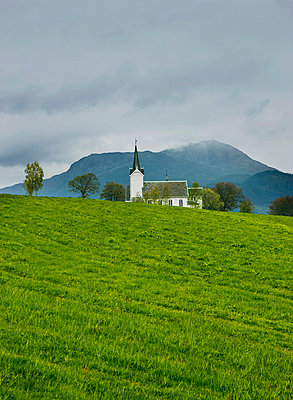 White church in mountains - p312m714739 by Bruno Ehrs