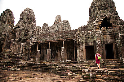 A woman  explores Angkor Wat, Cambodia - p343m964491 by Mark Fisher
