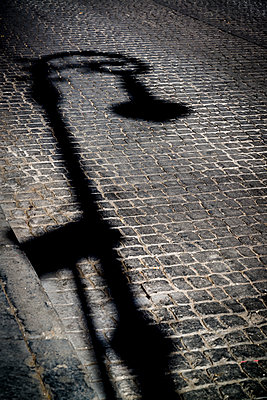 Shadow of street lamp, Mexico City, Mexico - p1170m1573344 by Bjanka Kadic