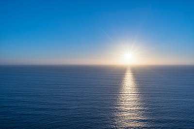 Sunset over the Tasman Sea - p1369m2064759 by Chris Hooton