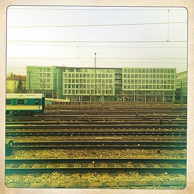 Train, tracks, office buildings, Hackerbrucke, Munich, Bavaria, Germany - p300m1009960 by Gerald Staufer
