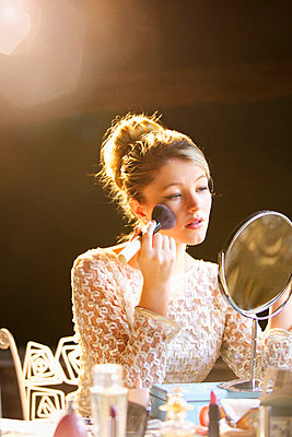 Young Woman Applying Blush - p669m713926 by Jutta Klee photography