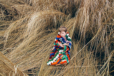 Little Boy in Colorful Blanket - p1262m1087729 by Maryanne Gobble