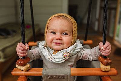 Baby in a swing - p1361m1460997 by Suzanne Gipson