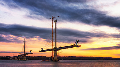 Scotland, Construction of the Queensferry Crossing Bridge at sunset - p300m1175653 by Scott Masterton