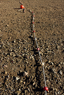 Float rope in the sand - p813m956628 by B.Jaubert