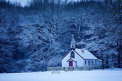 Isolated chapel in snow; St Georges Church; West End Village; nr. Esher; Surrey; UK - p924m806968f by Simon Battensby