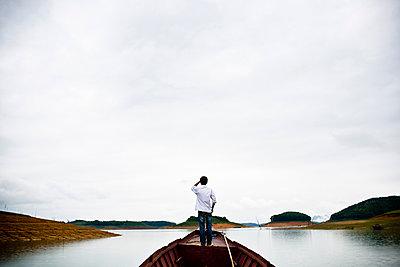 A boat on a reservoir in Vietnam. - p934m1093563f by Aaron Joel Santos