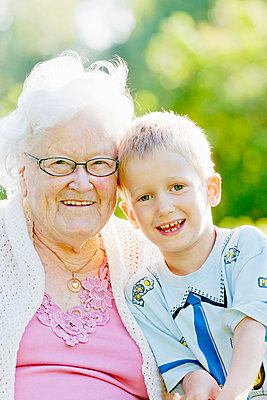 Portrait of boy with grandmother - p312m1551982 by Johner Images