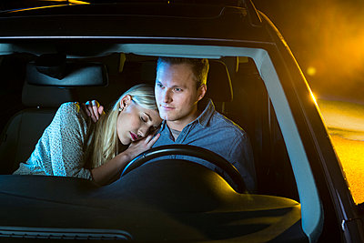 Couple driving at night - p890m886457 by Mielek
