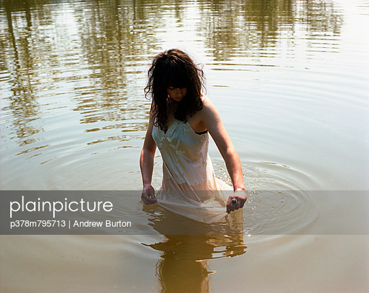 Woman in water - p378m795713 by Andrew Burton