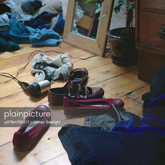 Untidy bedroom floor - p378m795317 by James Sebright