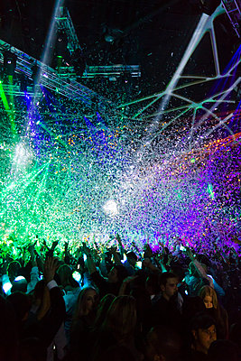Festival with laser show and confetti - p972m1160343 by Sesse Lind