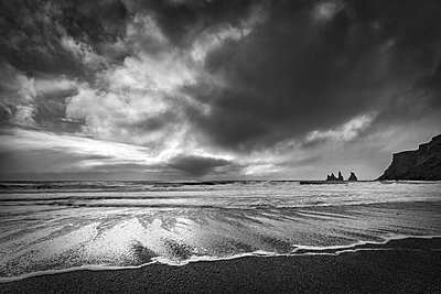 Sea stacks, tall cliffs and black basalt sandy beach at Vic on the southern coast, Iceland, Polar Regions - p871m1206555 by John Potter