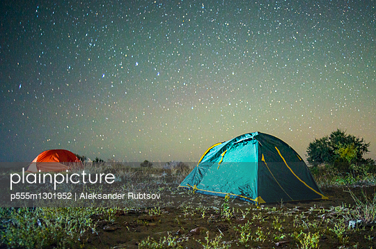 Camping tents under starry sky
