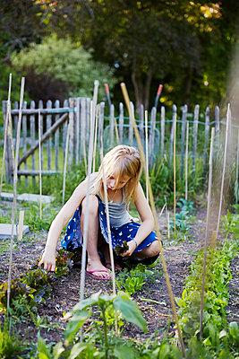Girl in garden - p312m2091979 by Anna Kern