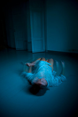 Sleepless woman on floor - p4130425 by Tuomas Marttila