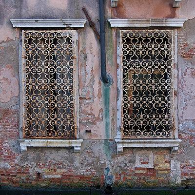 Window grilles, Venice. - p8552320 by Mike Burton